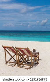 Beach chairs on the beach Atoll island Maldives.