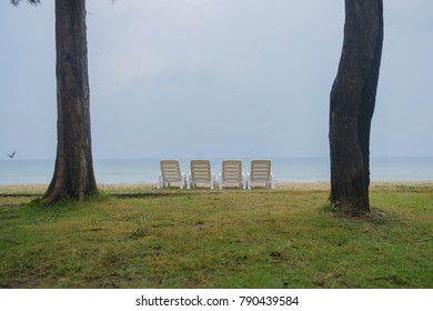 Beach chairs on the beach with blue sky in  thailand.