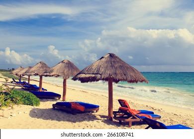 Beach chairs on exotic tropical white sand beach