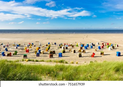 Beach chairs on the german island of Juist at a sunny day