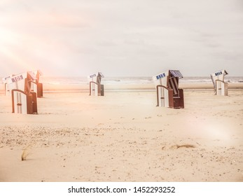 beach chairs on the german north sea coast with lens flare