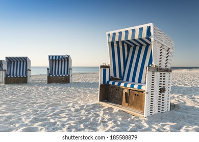 Beach - chairs on the island Sylt on late afternoon. Germany.