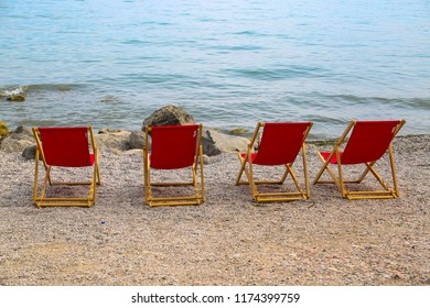 beach chairs on the beach, red beach chairs lonely on the beach