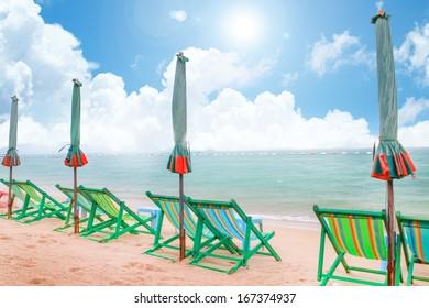 Beach chairs on the sand beach and sun