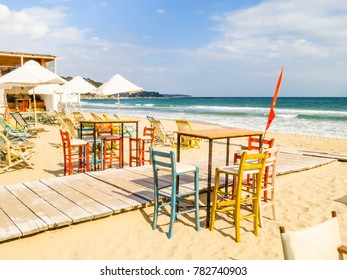 Beach chairs on the sandy beach. Coast of the Black Sea. South Beach, Varna, Bulgaria