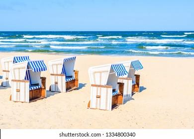 Beach chairs on sea coast near Baabe village on Rugen island, Baltic Sea, Germany