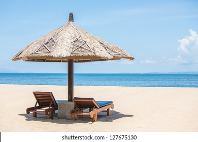 Beach Chairs on the white sand beach and with a blue sky