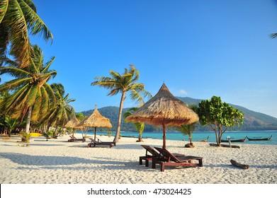 Beach Chairs and Paradise Beach in Summer