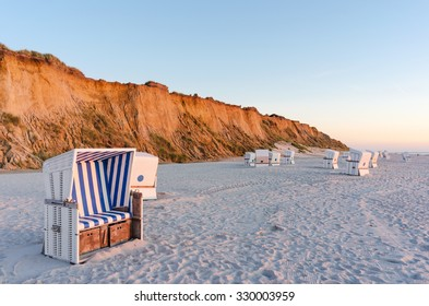 Beach chairs with Red Cliff near Kampen on the island of Sylt, Schleswig-Holstein, Germany