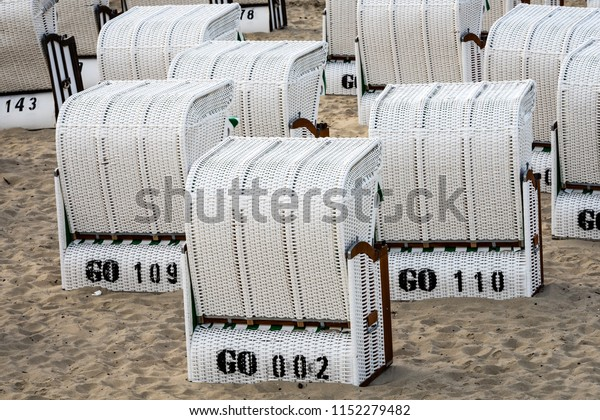 Beach chairs sitting on the fine sand of the famous beach in Sellin, Germany