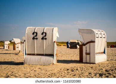 "Beach Chairs (""Strandkorb"" in German) at sand beach in northern gemany, frisian"