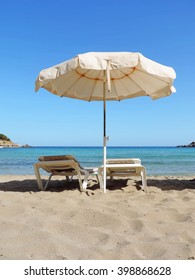 beach chairs and sunshade on the beach