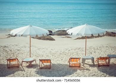 beach chairs and umberella on tropical ocean beach