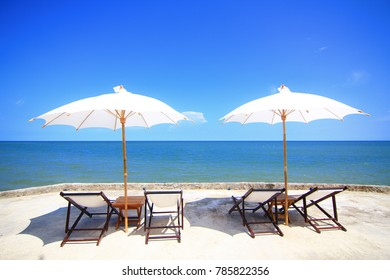 Beach chairs with umbrella and blue sky