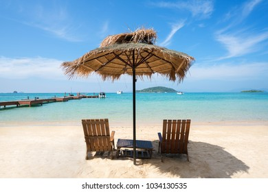 Beach Chairs and Umbrella on summer island in Phuket, Thailand. Summer, Travel, Vacation and Holiday concept.