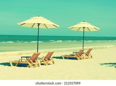 Beach chairs and beach umbrellas