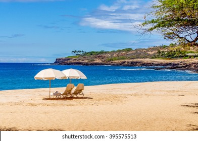 Beach chairs and umbrellas await the visitor to the island of Lanai, Hawaii.