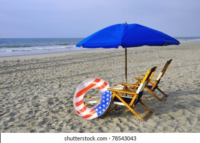 Beach Chairs and umbrellas by the sea shore