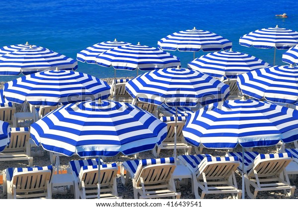 Beach chairs and umbrellas in Nice, French Riviera, France