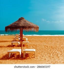 Beach Chairs umbrellas on the Ocean