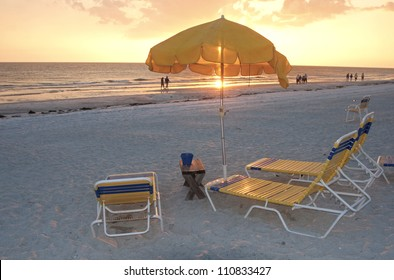 Beach chairs and umbrellas at sunset, Clearwater, Florida.