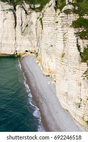 Beach and chalk cliffs in Etretat, Normandy, France, Europe.