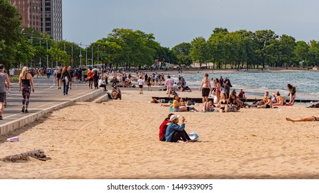 The beach in Chicago on a hot summer day  - CHICAGO, ILLINOIS - JUNE 11, 2019