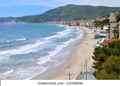 beach and city of of Alassio, Liguria, Italy in early spring