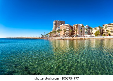Beach and cityscape. Torrevieja, Spain.
