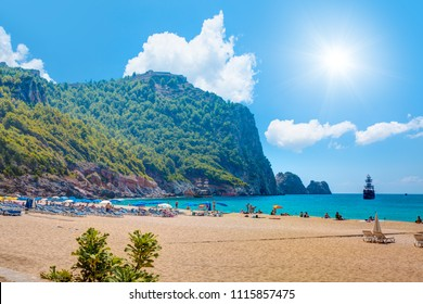 Beach of Cleopatra with sea and rocks of Alanya peninsula, Antalya, Turkey.