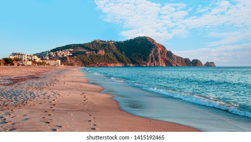 Beach of Cleopatra with sea and rocks of Alanya peninsula - Antalya, Turkey