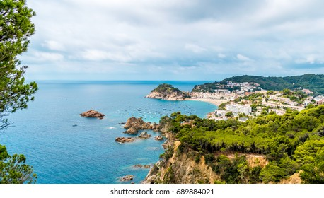 Beach and cliff landscape with blue / turquoise sea on the Costa Brava, Catalonia (Spain).