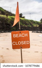 A Beach closed sign at the beach in the north shore of Oahu, Hawaii