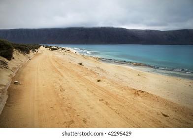 Beach with cloudy dark sky in Isla Graciosa, Canary Islands