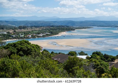 Beach and Coastline with Inlet and Houses Seen from a Lookout at Plettenberg Bay in South Africa