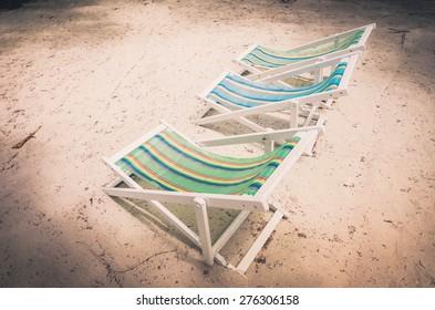 Beach colorful chair on the beach in Koh Samet Thailand vintage