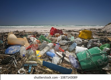 A beach completely polluted by plastic waste washed up by the ocean.