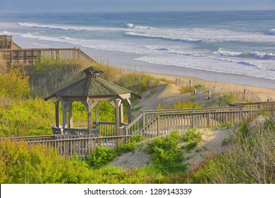 The beach in Corolla on the Outer Banks is a popular vacation destination in North Carolina.  Boardwalks and gazebos are offer access to the ocean.