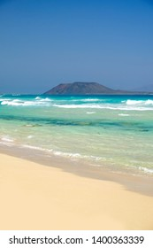 Beach Corralejo on the Canary Island Fuerteventura, Spain. View on the Islands Lobos and Lanzarote.