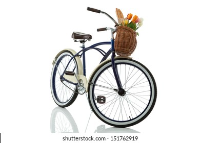 Beach cruiser with basket that has tulips