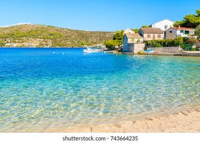 Beach with crystal clear sea water in Rogoznica town, Dalmatia, Croatia