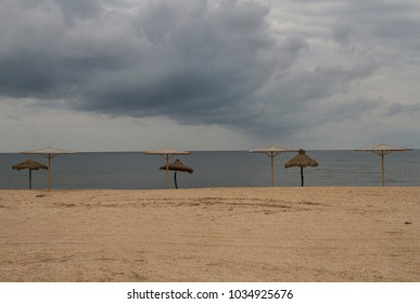 the beach is deserted, there is a storm. at sea the rainy season. on the gloomy sky of the cloud. the beach is deserted, there is a storm