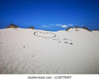 beach with dunes sand in Sardinia porto pino