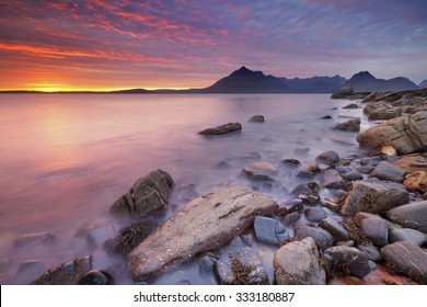 The beach of Elgol on the Isle of Skye, Scotland with The Cuillins in the background. Photographed at sunset.
