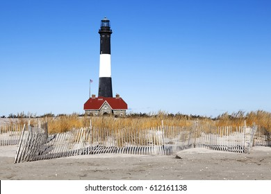 Beach fence and FIre Island lighthouse. Fire Island, Long Island, New York.