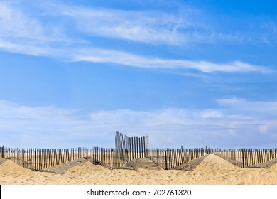 Beach fence preservation and sand. Beach fence helps preserve sand dunes on Fire Island, Long Island, New York.