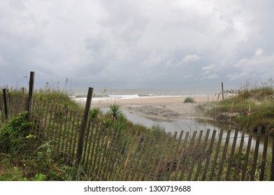 Beach fence protecting the dunes and sea oats with Atlantic Ocean in the background.