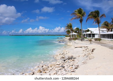 Beach of fine white sand, palm trees and azure sea in the Caribbean. Long Island, Bahamas