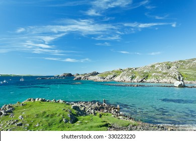 Beach at Fionnphort, Mull with turquoise sea water and blue sky, hebrides, Scotland, copy space