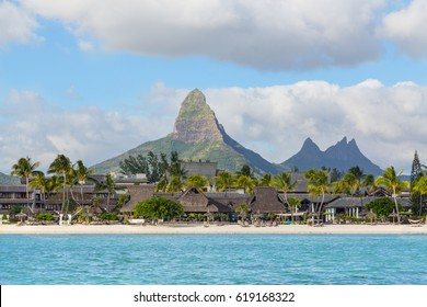 Beach of Flic en Flac with Piton de la Petite Riviere Noire Mauritius.